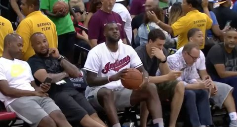 LeBron (wearing an Indians jersey) nonchalantly drills a shot from 40 feet sitting on the sideline