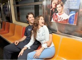 """NEW YORK, NY - JULY 16: """"Mane Man"""" C.J. Wilson and model Lisalla Montenegro ride the Head & Shoulders Branded 7 Train during MLB All-Star Week on July 16, 2013 in New York City. (Photo by D Dipasupil/Getty Images for Head & Shoulders) ORG XMIT: 173976805"""