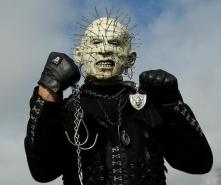 Oakland Raiders fan who calls himself HellRaider poses for a photograph in the O.co Coliseum parking lot before an NFL football game between the Oakland Raiders and the Cleveland Browns in Oakland, Calif., Sunday, Dec. 2, 2012. (AP Photo/Marcio Jose Sanchez)