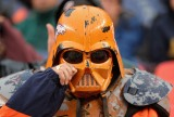 DENVER - OCTOBER 7: A fan of the Denver Broncos wipes tears from his darth vader helmet during the game against the San Diego Chargers at Invesco Field at Mile High October 7, 2007 in Denver, Colorado. The Chargers defeated the Broncos 41-3. (Photo by Doug Pensinger/Getty Images)