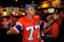 DENVER, CO - JANUARY 19: Felix Gonzales reacts to a call as he cheers on the Broncos while watching the AFC Championship game at the Tilted Kilt in Denver, Colorado on January 19, 2014. Broncos fans cheered on their team from sports bars around the city on Sunday. (Photo by Seth McConnell/The Denver Post)