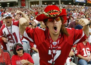"In this 2006 photo provided by the Arizona Cardinals, football fan Dustin Holmes of Tucson, Ariz., cheers during an NFL football game in Glendale, Ariz. Holmes, a Tucson software engineer who likes to go by the nickname ""Kidstallyn,"" says he hasn't missed a Cardinals game since he became a season-ticket holder in 1999. (AP Photo/Arizona Cardinals) ** NO SALES **"