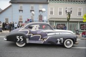 A Ravens car rides down Main St. during the Bel Air Christmas parade Sunday.