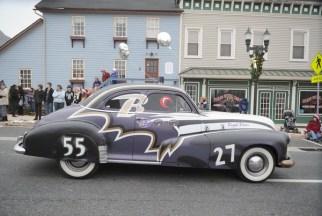 A Ravens car rides down Main St. during the Bel Air Christmas parade Sunday.