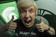 Carol Cook, 64, has been a hardcore Spartan fan since she was 16 years old. She admits to being loud and obnoxious about it at times. (Octavian Cantilli | The Grand Rapids Press)