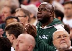 Mar 29, 2009; Indianapolis, IN, USA; Michigan State Spartans former player Magic Johnson watches the finals of the midwest region of the 2009 NCAA mens basketball tournament between the Spartans and Louisville Cardinals at Lucas Oil Stadium. Michigan State beat Louisville 64-52. Mandatory Credit: Jerry Lai-USA TODAY Sports