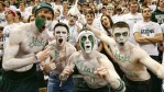 EAST LANSING, MI - JANUARY 25: Fans of the Michigan State Spartans get ready to cheer on their team during the game against the Michigan Wolverines at Breslin Center on January 25, 2014 in East Lansing, Michigan. (Photo by Leon Halip/Getty Images)