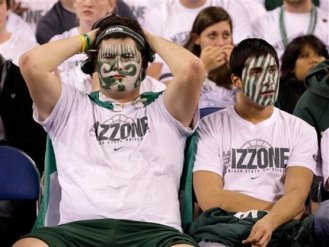 Michigan State fans look on after their team's 52-50 loss to Butler in a men's NCAA Final Four semifinal college basketball game Saturday, April 3, 2010, in Indianapolis. (AP Photo/Michael Conroy)