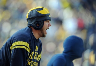 """Nathan Milliken, Ann Arbor, screams at the Wolverines after they took a knee to run out the first half rather than try and score against Wisconsin during Saturday, November 20th's clash between the Big Ten foes at Michigan Stadium. Despite the Badger's 48-28 win over Michigan, Milliken remains a fan of coach Rich Rodriguez saying, """"I loved Lloyd Carr, and he's very far from Lloyd Carr ... but I think if we're all patient enough, he'll (Rodriguez) make us awesome."""""""