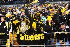 PITTSBURGH - JANUARY 11: Terrible towel waving fans of the Pittsburgh Steelers dressed and in black and gold with black and gold make-up cheering during the game against the San Diego Chargers on January 11, 2009 in Heinz Field at Pittsburgh, Pennsylvania. (Photo by Michael Fabus/Getty Images) Original Filename: 84329204.jpg