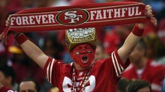 SANTA CLARA, CA - NOVEMBER 23: a San Francisco 49ers fan cheers for his team against the Washington Redskins at Levi's Stadium on November 23, 2014 in Santa Clara, California. (Photo by Thearon W. Henderson/Getty Images)