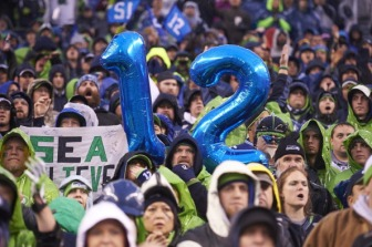 Football: NFC Playoffs: Seattle Seahawks fans in stands during game vs New Orleans Saints at CenturyLink Field. Seattle, WA 1/11/2014 CREDIT: Robert Beck (Photo by Robert Beck /Sports Illustrated/Getty Images) (Set Number: X157428 TK1 )