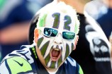 Sep 4, 2014; Seattle, WA, USA; Seattle Seahawks fan David Chilson of Seattle cheers during pre game warmups against the Green Bay Packers at CenturyLink Field. Mandatory Credit: Joe Nicholson-USA TODAY Sports ORG XMIT: USATSI-180012 ORIG FILE ID: 20140904_ajw_sn8_016.JPG