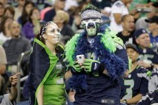 Seattle Seahawks fans watch the second half of a preseason NFL football game between the Seattle Seahawks and the San Diego Chargers, Friday, Aug. 15, 2014, in Seattle. (AP Photo/Stephen Brashear)