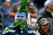 A bearded Seattle Seahawks fans watches warmups before an NFL football game between the Seattle Seahawks and the New York Giants, Sunday, Nov. 9, 2014, in Seattle. (AP Photo/Elaine Thompson) ORG XMIT: OTK