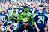 Seattle Seahawks fans cheer in the stands during an NFL football game between the Seattle Seahawks and the Denver Broncos, Sunday, Sept. 21, 2014, in Seattle. The Seahawks won in overtime 26-20.(AP Photo/Tom Hauck)