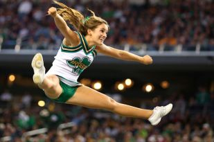 ARLINGTON, TX - OCTOBER 05: A Notre Dame Fighting Irish cheerleader at Cowboys Stadium on October 5, 2013 in Arlington, Texas. (Photo by Ronald Martinez/Getty Images)