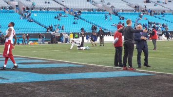 Cam stretching in the middle of the Cardinals warmups