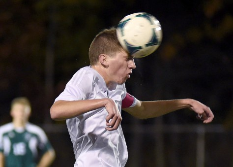 KRISTIN BAUER | CHRONICLE Westlake High School senior defender Brian Garruto (10) headers the ball during a game against Strongsville on Wednesday night, Oct. 28.