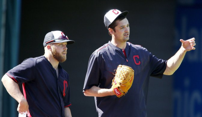 Cleveland Indians relief pitcher Andrew Miller, right, talks with relief pitcher Cody Allen during batting practice before a baseball game against the Minnesota Twins Monday, Aug. 1, 2016, in Cleveland. (AP Photo/Ron Schwane)