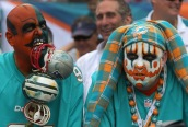 MIAMI GARDENS, FL - DECEMBER 15: Miami Dolphins fans were dressed for the occasion with painted faces as the New England Patriots take on the Miami Dolphins at SunLife Stadium. (Photo by Barry Chin/The Boston Globe via Getty Images)