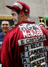 Apr 26, 2012; New York, NY, USA; Washington Redskins fan Andy Curley poses with a jersey displaying the names of former Redskins quarterbacks before the 2012 NFL Draft at Radio City Music Hall. Mandatory Credit: Jerry Lai-US PRESSWIRE